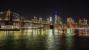 Night Manhattan and Brooklyn Bridge. The famous business district of New York. The flow of the river beautifully stock video
