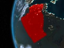 Algeria in red at night. Night map of Algeria as seen from space on planet Earth. 3D illustration Royalty Free Stock Images