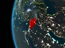 Syria in red at night. Night map of Syria as seen from space on planet Earth. 3D illustration. Elements of this image furnished by NASA Stock Photography