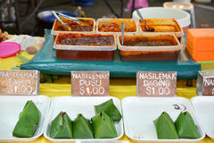 Night market food in Brunei. Darussalam. Nasi Lemak is ubiquitous in Malaysia and Brunei - traditional meal made of meat, rice, coconut milk , served in banana Stock Photo