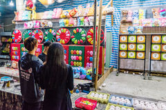 This is a night market game. TAIPEI, TAIWAN - MAY 20: This is a game in Shilin night market where people can win soft toys by hitting balloons with darts it is a stock image