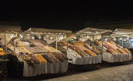 Night market in Jemaa el-Fnaa, Medina of Marrakech, Morocco. Displaying a variety of dried fruits including dates, figs and apricots royalty free stock photo