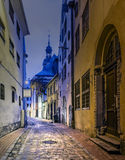 Night in medieval street in old Riga city, Latvia Royalty Free Stock Photo
