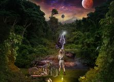 Night meeting of travelers in the tropical jungle. Tropics, night jungle. Meeting of travelers near the waterfall royalty free stock photo