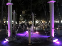 Night in Milano Marittima. Fountain of Milano Marittima with purple lights Stock Photography