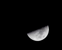 Night Moon. Large half moon shot taken with zoom lens Stock Photo