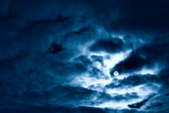 Night moon and clouds. Blue tint Stock Photos