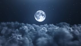 Night moon over the clouds