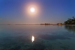 Night. The moon over the sea and reflection in water Stock Image