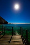 Night. The moon over the sea and reflection in water. Royalty Free Stock Photos