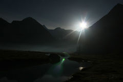 Night moon and river. Night. The river flows the mountain sleep in a fog moon shines stock photography