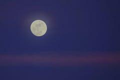 Night moon and sunset glow Stock Photo