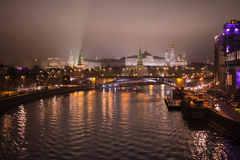 Night Moscow river with rich lights and a view of a boat traveling to Kremlin stock photo