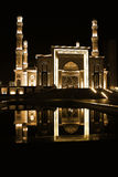 Night mosque reflection on the water Stock Image