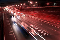 Night motorway. Fast movement of cars on night motorway stock photos