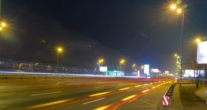 Night motorway, Zhytomyr Square, Kiev long exposure. With traces of light from cars stock images