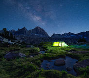 Night mountain landscape with illuminated tent. Stock Images