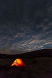 Night mountain landscape with illuminated tent Royalty Free Stock Photography