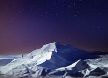 Polar night mountain landscape star sky South pole Antarctica. Night mountain landscape star sky South pole Antarctica. polar night Royalty Free Stock Images