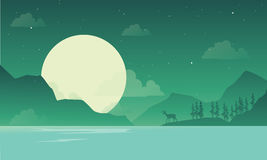 At night mountain scenery with deer silhouette Royalty Free Stock Images