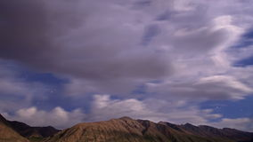 Night in the mountains. Time Lapse. 4K. Stars hide the clouds. Approaching storm. Kyrgyzstan, Tien Shan. Time Lapse. UltraHD (4K). Video. UltraHD (4K stock video footage