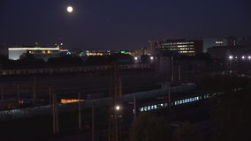 Night movement of trains on a railway junction in moon light stock video