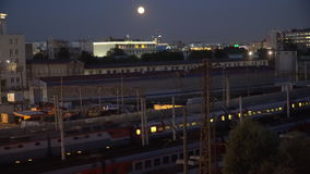 Night movement of trains on a railway junction in moon light stock footage