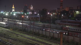 Night movement of trains on a railway junction in moon light stock video footage