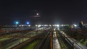 Night movement of trains on a railway junction in moon light. Moscow Royalty Free Stock Photos
