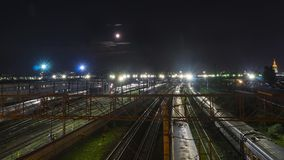 Night movement of trains on a railway junction in moon light. Moscow Royalty Free Stock Photo