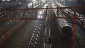 Night movement of trains on a railway junction. Moscow stock video