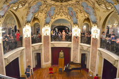 Night of Museums in Bucharest - George Enescu National Museum. Visitors enjoying classic music at George Enescu National Museum, Cantacuzino Palace, with the Royalty Free Stock Images