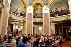 Night of Museums in Bucharest - George Enescu National Museum. Visitors enjoying classic music at George Enescu National Museum, Cantacuzino Palace, with the Royalty Free Stock Photography