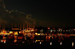 Night at Naples Bay marina. Boats and yachts at Naples Bay marina after sunset Stock Photography