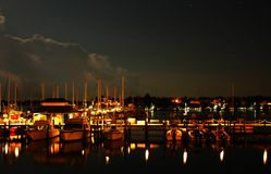 Night at Naples Bay marina. Boats and yachts at Naples Bay marina after sunset Stock Images