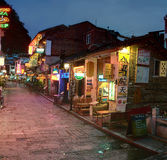 Night narrow street in small town Yangshuo, cafes, restaurants, Stock Photography