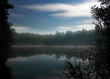 Night near the foggy lake Stock Photos