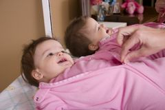 Night, Night. Happy baby girl getting her jamies zipped up for bed royalty free stock photos