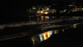 Night Ocean Waves in the Light of Coastal Town stock video
