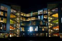 Night office. Building with light in windows Stock Photo