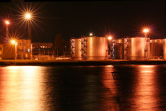 Night oil tanks in the harbor #1. Night oil tanks in the harbor with reflection on the sea Royalty Free Stock Photos