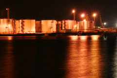 Night oil tanks in the harbor #2. Night oil tanks in the harbor with reflection on the sea Royalty Free Stock Photo