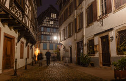 Night old city cobblestones lonely passers Stock Photos