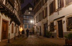 Night old city cobblestones lonely passers Stock Photos