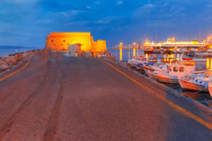 Night old harbour of Heraklion, Crete, Greece. Old harbour of Heraklion with Venetian Koules Fortress, boats and marina during blue hour, Crete, Greece. Boats Royalty Free Stock Photos