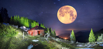 Night about the old hut Royalty Free Stock Image