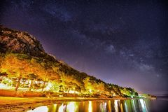 Night in Omis. Galaxy over the Croatian town of Omis stock photography