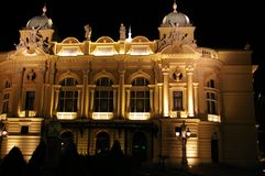 Night Opera house. A lightened Opera house building at night Royalty Free Stock Photos