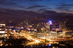 Night Oslo. Kind on city Oslo after call of the sun. A night view of Oslo, Norway. The photograph has a yellow-brown hue as city lights set the area aglow Stock Photos