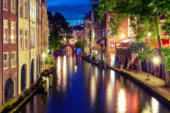 Night Oudegracht and bridge, Utrecht, Netherlands. Canal Oudegracht in the night colorful illuminations in the blue hour, Utrecht, Netherlands. Used toning Royalty Free Stock Images